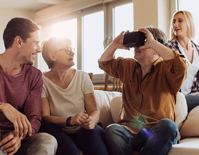 Family using a virtual reality technology as walk-through of luxury houses.