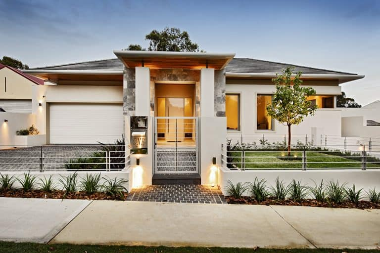 Entrance or front view of a luxury home with a 12-Month home guarantee.