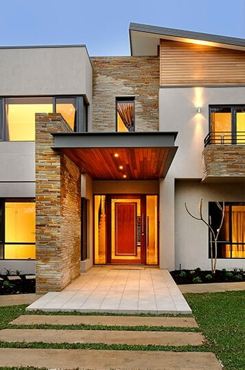 Entrance view of a luxury home that represents one of the testimonials.